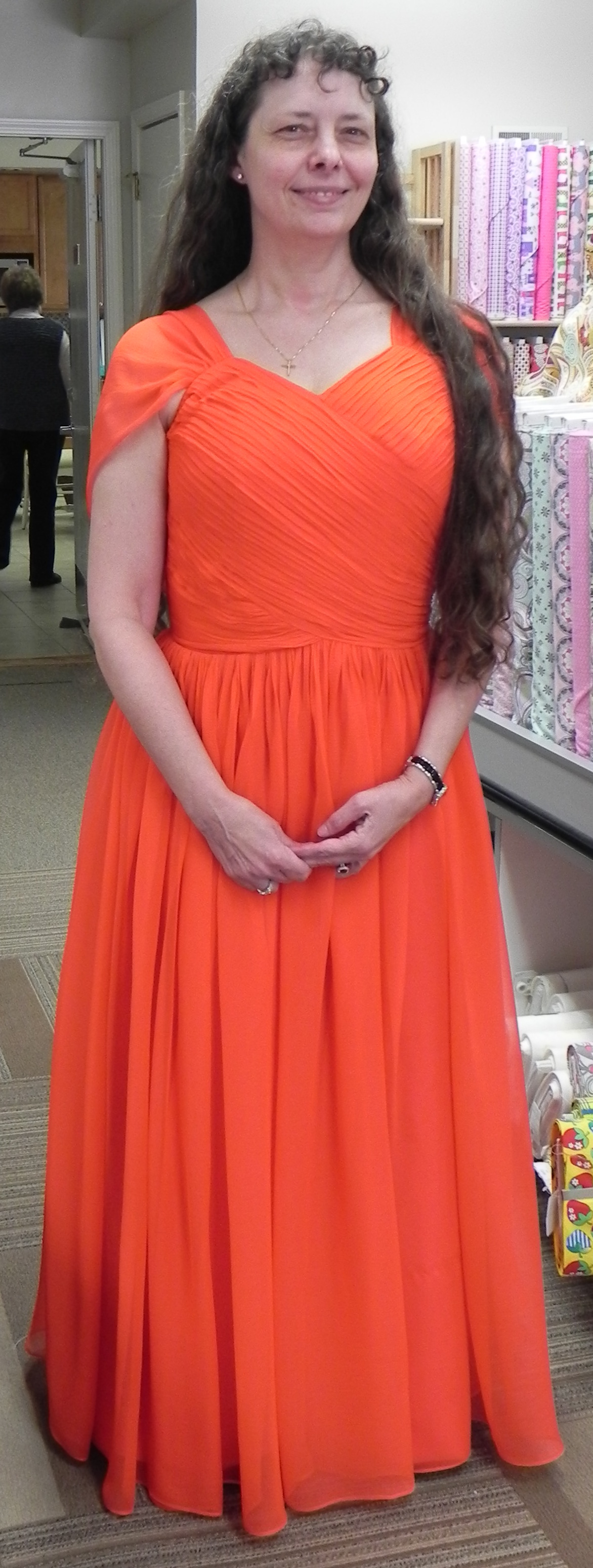 Picture of Store Owner in Orange Dress